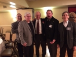 Coach Schluntz with football teammates Don Cole, Andy Levas,John Merrick and Alan Nathan